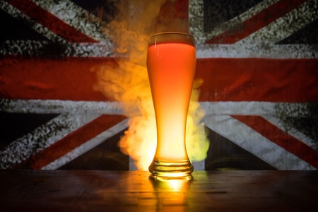 Soccer 2018. Single beer glass on table at dark toned foggy background. Support England with beer concept. Selective focus Stock Photo