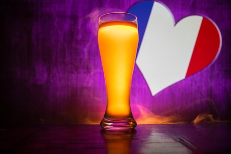 Soccer 2018. Single beer glass on table at dark toned foggy background. Support France with beer concept. Selective focus Stock Photo