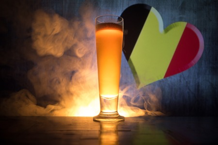 Soccer 2018. Single beer glass on table at dark toned foggy background. Support Belgium with beer concept. Selective focus Stock Photo