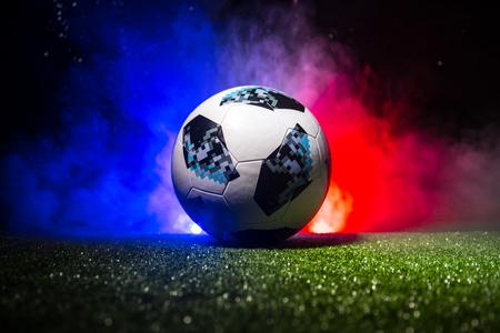 BAKU,AZERBAIJAN - JULY 12, 2018 : Creative concept. Official Russia 2018 World Cup football ball The Adidas Telstar 18 on green grass. Support France team concept. Selective focus