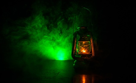 Oil Lamp Lighting up the Darkness or Burning kerosene lamp background, concept lighting