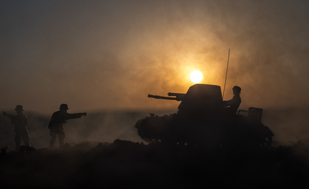 War Concept. Military silhouettes fighting scene. World War German Tanks and soldiers silhouettes at sunset. Attack scene. Armored vehicles. Tanks battle