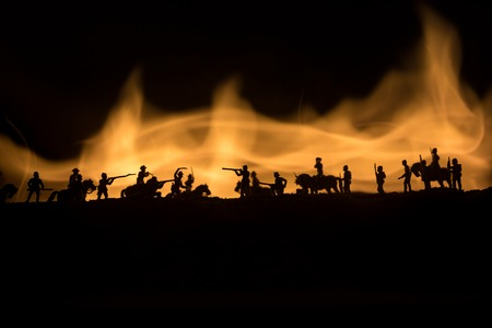 American Civil War Concept. Military silhouettes fighting scene on war fog sky background. Attack scene. Selective focus Stock Photo