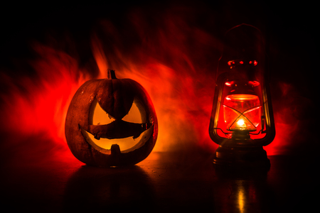 Halloween scene with pumpkin and oil lamp. .Happy Halloween holiday background with old vintage oil lamp on dark toned foggy background. Space for text Stock fotó - 111020269