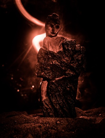 Horror silhouette of scary figure at night. Female demon. Demons coming. Slhouette of devil or monster figure on a background of fire. Horror view