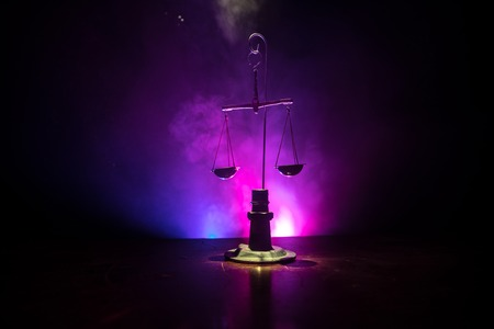 Justice scale with dark toned foggy background. Justice concept. Scale is symbol of justice. Selective focus Standard-Bild