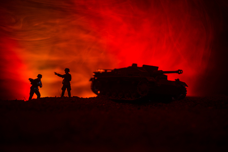 War Concept. Military silhouettes fighting scene on war fog sky background, World War German Tanks Silhouettes Below Cloudy Skyline At night. Attack scene. Armored vehicles. Tanks battle