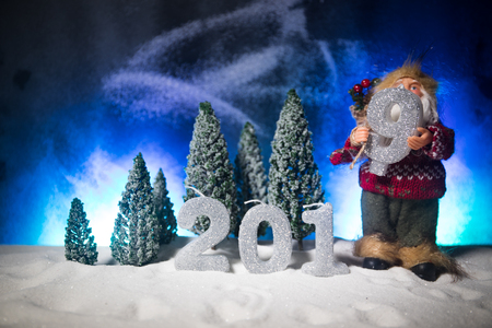 2019 digits on the snow. Happy new 2019-year concept. Empty space for your text. Artwork decorated background.