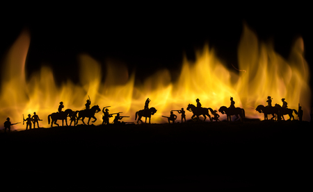 American Civil War Concept. Military silhouettes fighting scene on war fog sky background. Attack scene. Selective focus