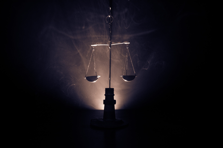 Justice scale with dark toned foggy background. Justice concept. Scale is symbol of justice. Selective focus Imagens