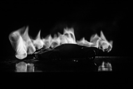 The car in the shadows with glowing lights in low light, or silhouette of sport car dark background. Selective focus Banque d'images