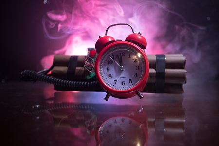 Image of a time bomb against dark background. Timer counting down to detonation illuminated in a shaft light shining through the darkness, conceptual image Stok Fotoğraf