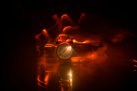 Image of a time bomb against dark background. Timer counting down to detonation illuminated in a shaft light shining through the darkness, conceptual image Stock Photo