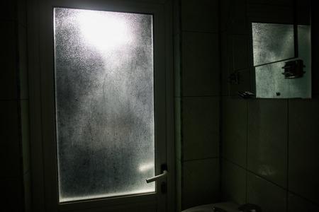 Horror silhouette of person in window. Standard-Bild