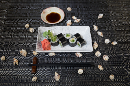 Japanese sushi set with ready to serve. Beautiful eastern style table decoration with sushi. Selective focus