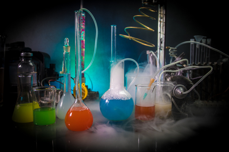 Pharmacy and chemistry theme. Test glass flask with solution in research laboratory. Science and medical background. Laboratory test tubes on dark toned background , science research equipment concept Banque d'images - 116101580