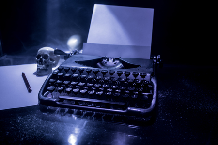Old fashion typewritter on dark foggy background. Close up of vintage typewritter machine. Selective focus Stockfoto