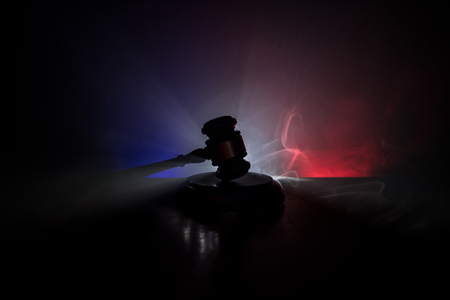 Law theme, mallet of the judge on wooden desk with Lady Justice Statue. Law gavel on dark foggy background with light. Selective focus Stok Fotoğraf