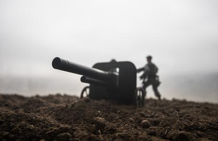 Battle scene. Silhouette of old field gun standing at field ready to fire. Creative artwork decoration. Selective focus 版權商用圖片