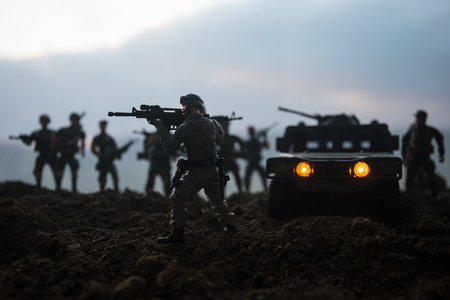 Military patrol car on sunset background. Army war concept. Silhouette of armored vehicle with soldiers ready to attack. Artwork decoration. Selective focus