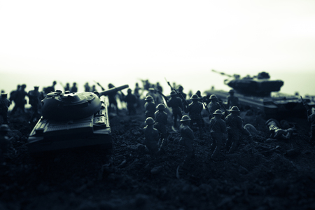 War Concept. Military silhouettes fighting scene on war fog sky background, World War Soldiers Silhouettes Below Cloudy Skyline at sunset. Attack scene. Armored vehicles. tank in action