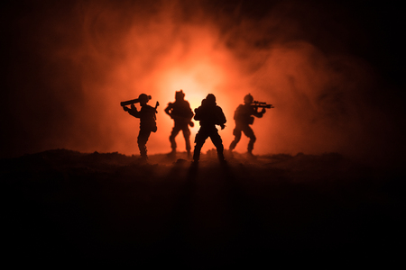 Military soldier silhouette with gun. War Concept. Military silhouettes fighting scene on war fog sky background, World War Soldier Silhouette Below Cloudy Skyline At night. Attack scene
