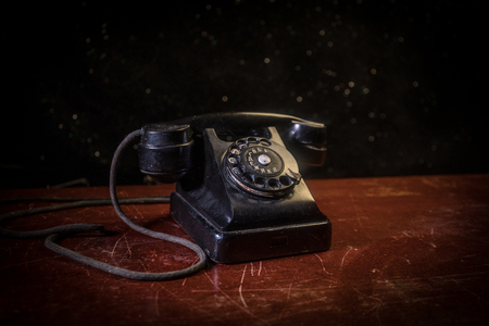 old black telephone on old wood plank with art dark background with fog and toned light. empty space. Selective focus Standard-Bild - 119233216