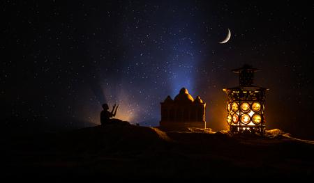 Ornamental Arabic lantern with burning candle glowing at night. Festive greeting card, invitation for Muslim holy month Ramadan Kareem.