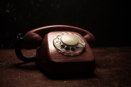 old black telephone on old wood plank with art dark background with fog and toned light. empty space. Selective focus Standard-Bild - 120672015