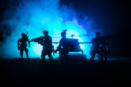 Artwork decoration. Soldiers in the desert during the military operation with combat helicopter or Helicopter assault special forces. Selective focus Imagens