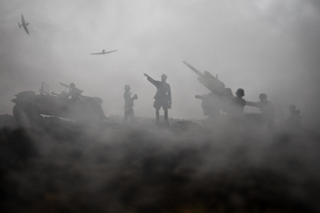 An anti-aircraft cannon and Military silhouettes fighting scene on war fog sky background. Allied air forces attacking on German positions. Artwork decorated scene. Selective focus Stock Photo