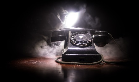 old black telephone on old wood plank with art dark background with fog and toned light. empty space. Selective focus Standard-Bild - 121516767
