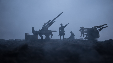 An anti-aircraft cannon and Military silhouettes fighting scene on war fog sky background. Allied air forces attacking on German positions. Artwork decorated scene. Selective focus Imagens