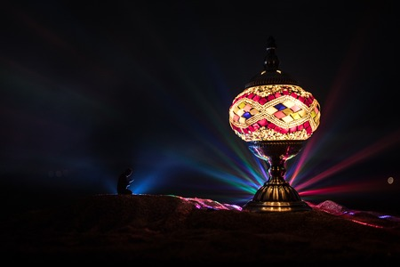 Ornamental Arabic lantern with burning candle glowing at night. Festive greeting card, invitation for Muslim holy month Ramadan Kareem. Reklamní fotografie