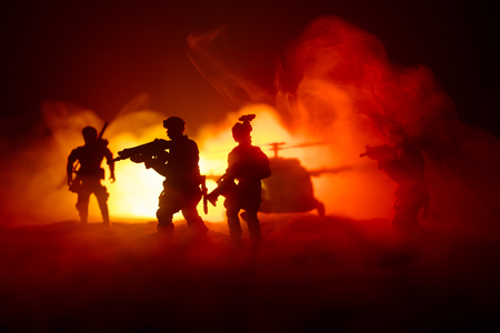 Artwork decoration. Soldiers in the desert during the military operation with combat helicopter or Helicopter assault special forces. Selective focus Stockfoto