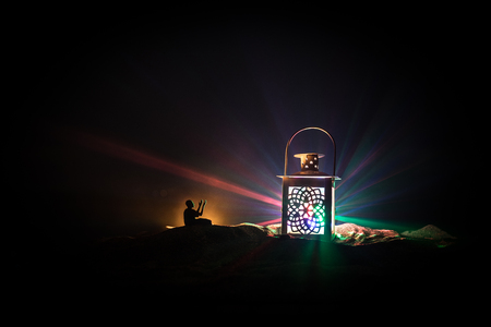 Ornamental Arabic lantern with burning candle glowing at night. Festive greeting card, invitation for Muslim holy month Ramadan Kareem. Stock fotó