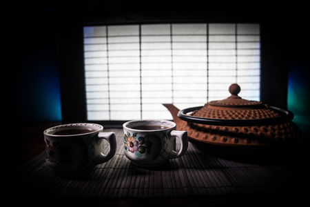 Tea concept. Japanese tea ceremony culture east beverage. Teapot and cups on table with bamboo and tradicional Japan ornament decor elements Reklamní fotografie - 123048444
