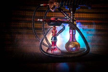Hookah hot coals on shisha bowl on dark foggy background. Stylish oriental shisha. Creative concept Stockfoto