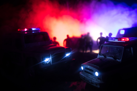 Police cars at night. Police car chasing a car at night with fog background. 911 Emergency response police car speeding to scene of crime. Selective focus Reklamní fotografie
