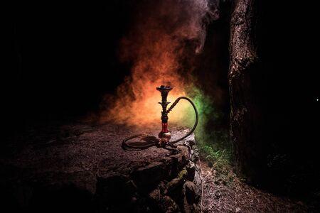 Hookah hot coals on shisha bowl with black background. Stylish oriental shisha at the forest during night time 版權商用圖片