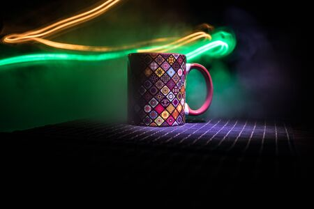 Beautiful eastern style textured ceramic cup of coffee (or tea) with smoke over dark toned background. Close up view. Stock fotó