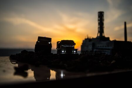 Creative artwork decoration. Chernobyl nuclear power plant at night. Layout of abandoned Chernobyl station after nuclear reactor explosion. Selective focus