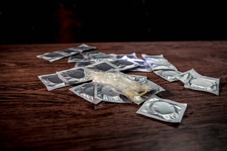 Give condom safe sex concept. Prevent infection and Contraceptives control the birth rate or safe prophylactic. Condom ready to use on table. Creative artwork ideas. Leave space for text Stockfoto