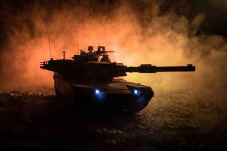 War Concept. Armored vehicle silhouette fighting scene on war foggy sky background at night. American tank ready to fight. Creative decoration Stok Fotoğraf