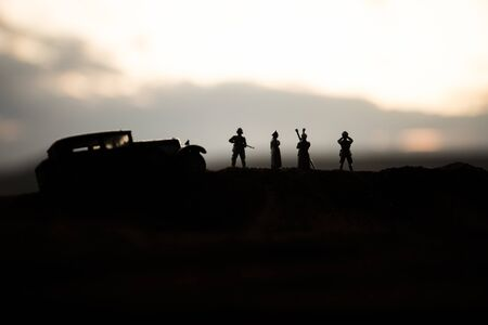 War concept. Creative composition. Silhouette of German general at the desert. Army commanders watching to the battle. Military fighting silhouettes on sunset