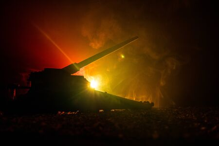 German canon on the train. World wars weapon resized artwork on table with dark toned foggy background. Battle scene. Selective focus