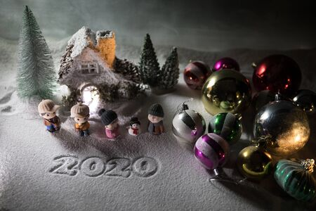 Winter holidays concept. Christmas background with baubles, on snow, free space for text. Christmas decoration. Festive background. Empty space for text Reklamní fotografie