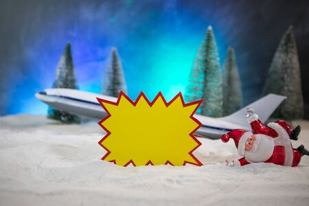 Merry Christmas and Happy new years travel concept background for winter trip. Christmas background with airplane. Creative artwork decoration on snow. Selective focus.