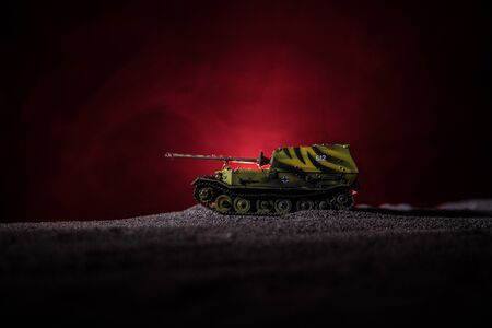 War Concept. Military silhouettes fighting scene on war fog sky background, Silhouette of armored vehicle below Cloudy Skyline At night. Attack scene. Tanks battle. Artwork decoration Archivio Fotografico - 134749083