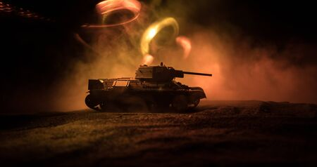 War Concept. Military silhouettes fighting scene on war fog sky background, Silhouette of armored vehicle below Cloudy Skyline At night. Attack scene. Tanks battle. Artwork decoration Archivio Fotografico - 134749085